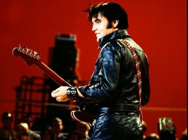 Elvis in black leather catsuit