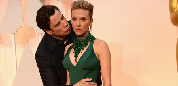 Scarlett Johansson and John Travolta kissing